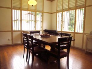 Dining area with dining table and six chairs
