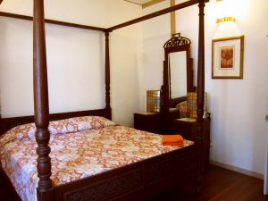 Wooden four poster king bed