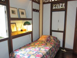 The back bedroom near the kitchen fits two single beds