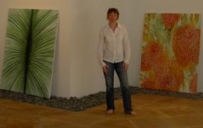 Anne standing in the underground gallery at Rimbun Dahan, surrounded by her work.