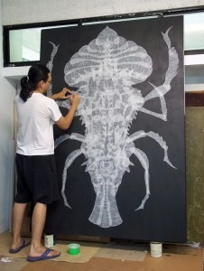 Haslin Ismail in his studio at Rimbun Dahan, with his work for the 2011 Art for Nature exhibition.