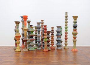 Archipelago, 2016, dimensions variable, Melamine tableware, Puttyfilla, sand, cement and enamel paint